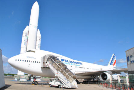 A Boeing 747 and an Arianne space rocket displayed at the Le Bourget Museum of Air & Space in Paris.