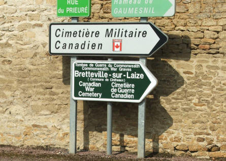 Signs showing the way to the Bretteville-sur-Laize Canadian War Cemetery - Cintheaux.
