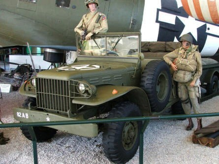 American paratroopers with a small truck at the Airborne museum in Sainte Mère Eglise.