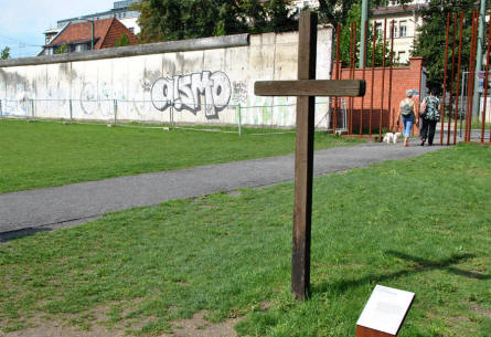 A simple cross displayed at the Berlin Wall Memorial.