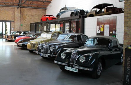Some of the cars on display at the Classic Remise Berlin in April 2011.