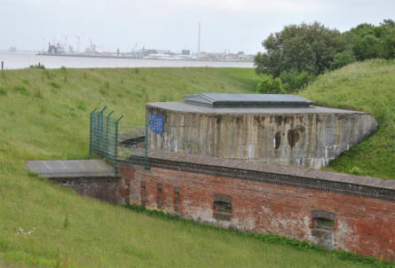 The wall surrounding Fort Kugelbake - and Cuxhaven in the background.