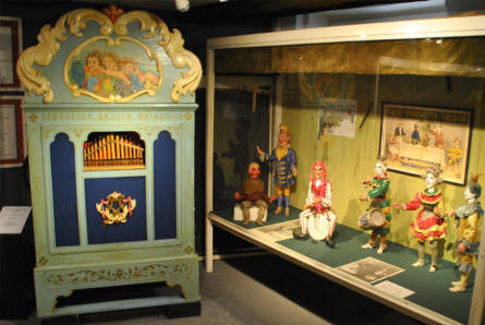 Some of the European dolls and a small vintage organ displayed at the Museum of Theatre Puppets in Lübeck.