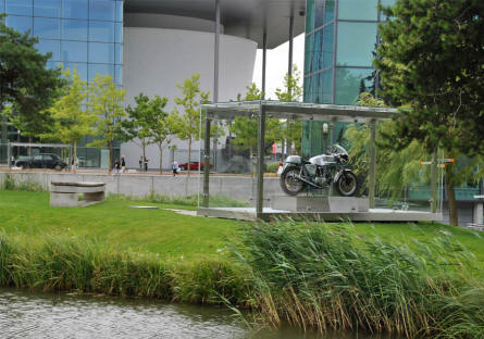 A vintage motorcycle displayed in the garden inside the Autostadt area in Wolfsburg.