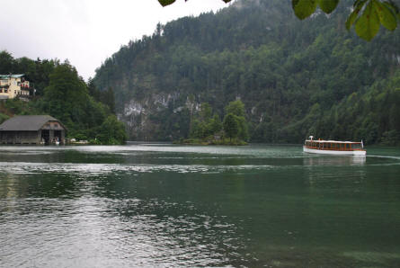 One of the tour boats leaving the village of Königssee to sail into the Lake Königssee. These tour boats are very quiet as they a driven by electricity.