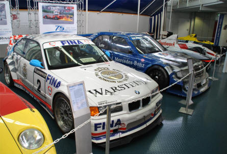 Some of the more modern race cars displayed at the Hockenheim-Ring Motor Sports Museum.