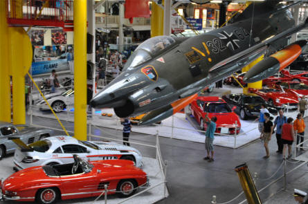 Some of the many classic cars displayed at the Sinsheim Technical Museum. A Fiat G.91 jet fighter is hanging from the ceiling.