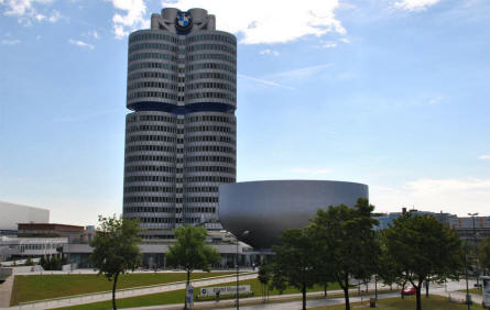 The BMW Museum in Munich (München) is located just next to the BMW headquarter (the tall cylindrical building) - and has a unique cup like design.