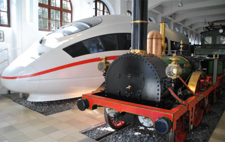 The oldest German locomotive (Adler) and the most modern German locomotive (ICE) displayed at the DB Museum Nürnberg.