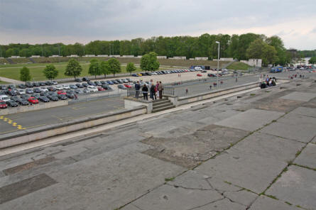 A section of the Zeppelinfeld - at the Former Nazi PartyRally Grounds in Nürnberg. The original rally grounds covered the current road/parking area and all of the grass area behind the parked cars.