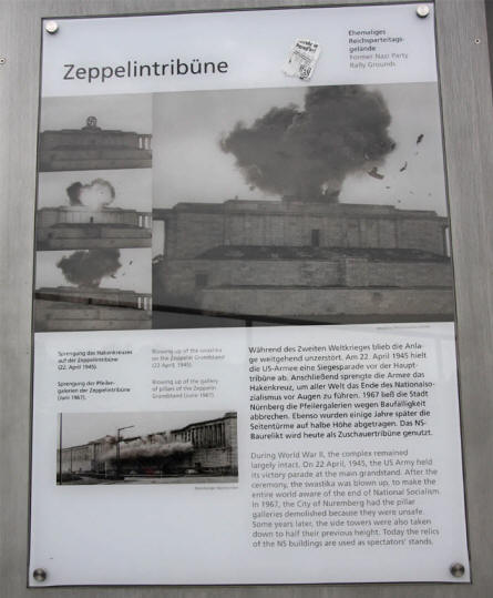 A picture showing the demolition of the Nazi symbols on top of the Zeppelinfeld - at the Former Nazi Party Rally Grounds in Nürnberg. This demolition was performed by the American troops in April 1945 just before the end of World War II.