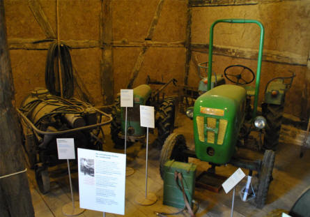 "Different types of farm equipment displayed at the Open-air museum ""Beuren""."
