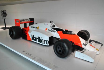 A 1986 McLaren TAG MP 4/2 C Formula 1 race car displayed at the Porsche Museum in Stuttgart. The car is powered by a V6 turbo charged Porsche engine.