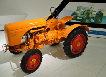 A classic Porsche tractor displayed at the Porsche Museum in Stuttgart.
