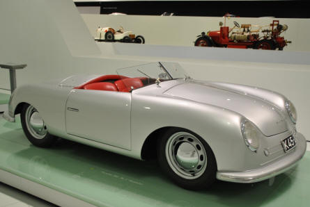 "A classic 1948 Porsche 356 ""Nr. 1"" roadster displayed at the Porsche Museum in Stuttgart."