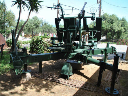 A World War II anti-aircraft gun displayed at small museum at the entrance to the Maleme German War Graves on Crete.