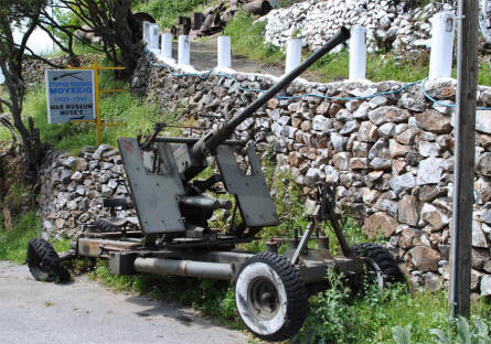 A World War II anti-aircraft gun displayed on the road outside the War Museum of Askifou on Crete.