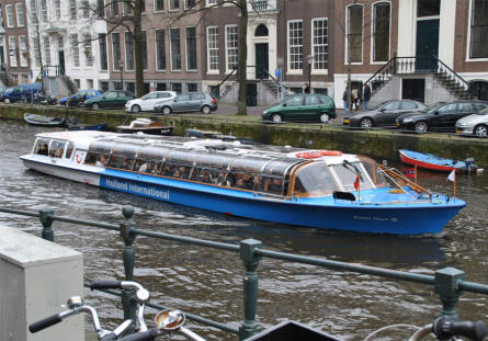 One of the many canal tour boats in Amsterdam. A canal cruise is a very good way to discover the city.