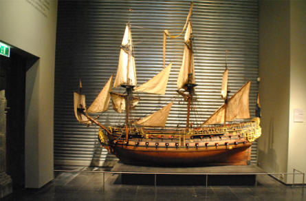 A very detailed scale model of a vintage ship displayed at the Rijksmuseum in Amsterdam.