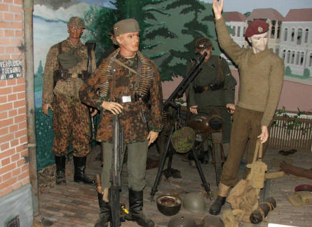 "A full-size diorama showing a British paratrooper that surrenders during  ""Operation Market Garden"" displayed at the Arnhem War Museum."