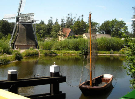 A Dutch windmill and fishing boat displayed at the National Heritage Museum (Openluchtmuseum) in Arnhem.
