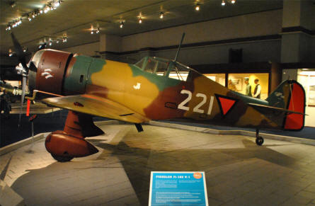 A historical Dutch World War II Fokker D-XXI fighter displayed at the Soesterberg Aviation Museum.