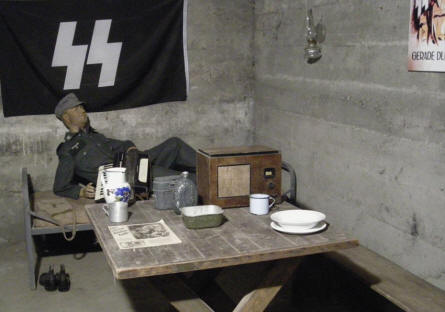 German World War II soldier in from of an SS flag at the Citadella 1944 Bunker in Budapest.