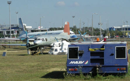 Airport equipment, commercial airliners and helicopter at the open-air Aircraft Exhibition at Ferihegy Airport - Budapest.