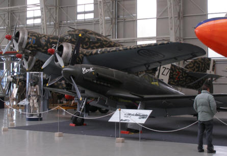 A World War II Fiat G-55 fighter and Savoia-Marchetti S.M.79 bomber at the Italian Air Force Museum.