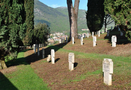 Some of the many World War II tombstones at the German War Cemetery in Caira - near Monte Cassino. Notice very rough but beautiful terrain.