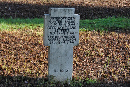 A typical World War II tombstone at the German War Cemetery in Caira - near Monte Cassino. This stone stone has 3 names on it - some have more or less.