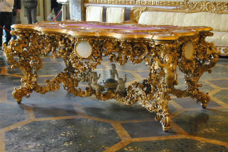 A vintage royal table displayed at the Royal Palace of Caserta.