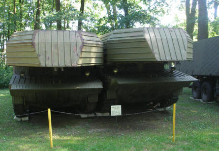 Two combat boats on top of two armoured vehicles displayed at the Lubuskie Military Museum.