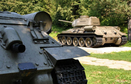 Two Russian World War II T-34 tanks displayed outside the Dukla Pass Museum.