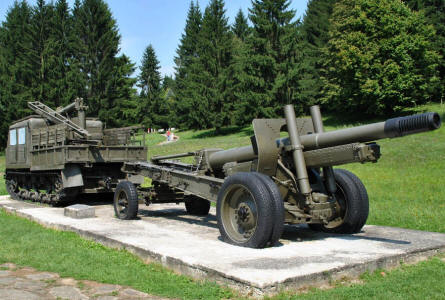 A Russian World War II tracked artillery tractor with a heavy artillery gun displayed outside the Dukla Pass Museum.