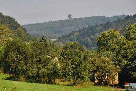 The 52 meter high Dukla Pass Observation Tower - seen in the background - is built on the altitude 655 in the original place as the commander's observation post of General Ludvik Svoboda celebrating the 30th anniversary of Carpathian-Dukla Operation.