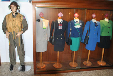 Some of the many vintage and classic airline uniforms displayed at the Museum of the Airport of Malaga.