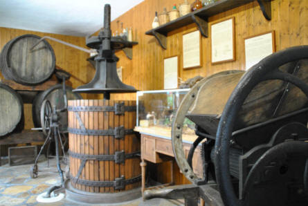 Equipment for olive oil production displayed at the Ethnological Museum in Mijas.