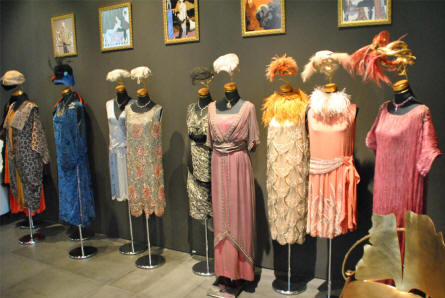 Some of the haut couture and other designer clothes  displayed at the Automobile Museum of Málaga.