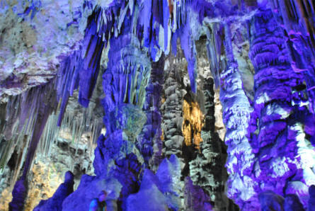 Some of the many beautiful limestone stalactites at the St. Michaels Cave in Gibraltar. Here in a purple light.