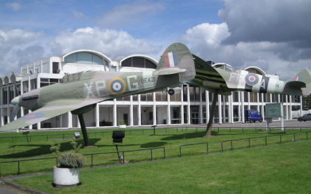 Spitfire and Hurricane as gate guards outside the RAF Museum at Hendon.