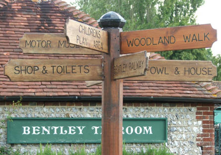 A signpost at the entrance to the Bentley Wildfowl & Motor Museum.